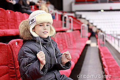 Boy get behind favourite command on  hockey match