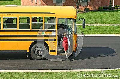 Boy Getting off School Bus