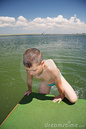 Boy getting out of sea
