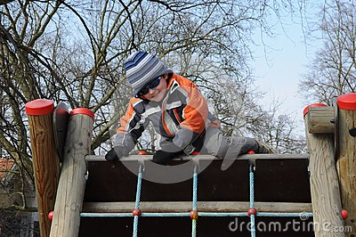 Boy getting over barrier
