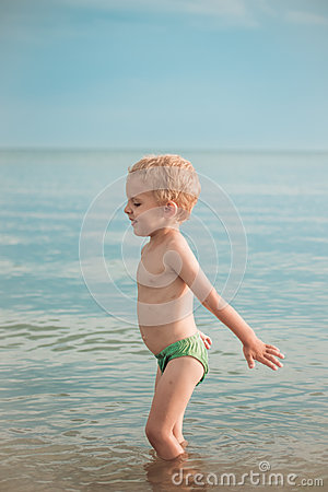Free Boy Getting Ready To Jump To Dive Deep Stock Photography - 56568082