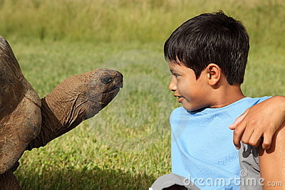 Boy and giant tortoise