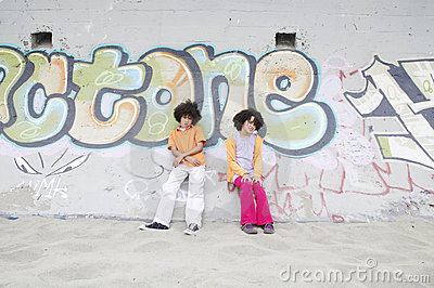 Boy and girl against a wall
