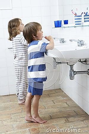 Boy And Girl In Bathroom Brushing Teeth Stock Photo Image 54972416