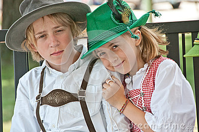 Boy and girl in Bavarian-style clothing