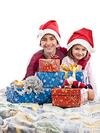 Boy and girl in bed with Christmas presents