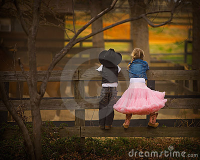 Boy and girl on fence