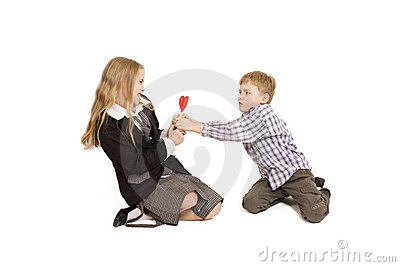 Boy and girl fighting over a lolipop