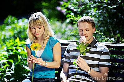 Boy and girl with flowers on a romantic date
