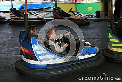 Boy and a girl at the fun fair