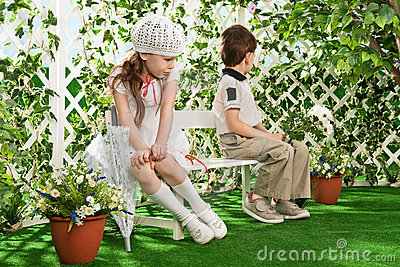 Boy and girl in the gazebo on the bench
