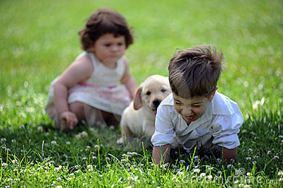 Boy and girl with his dog in the park