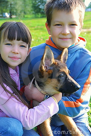 Boy and girl holding dog