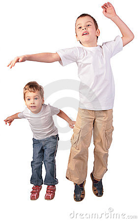Boy and girl jumping
