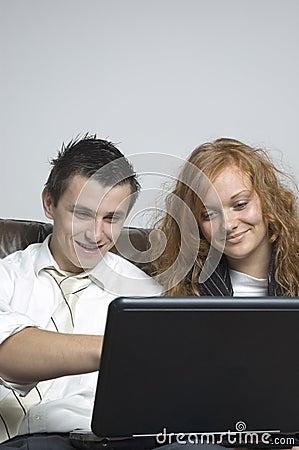 Boy & girl / laptop
