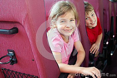Boy and girl look in bus