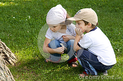 Boy and girl looking