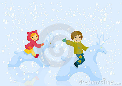 Boy and girl plaing outdoore in winter day