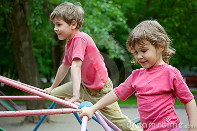 The boy and the girl play a children s playground