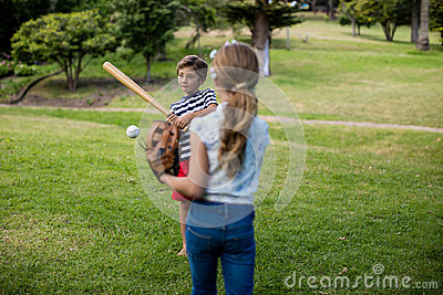 Boy and girl playing baseball Stock Photo