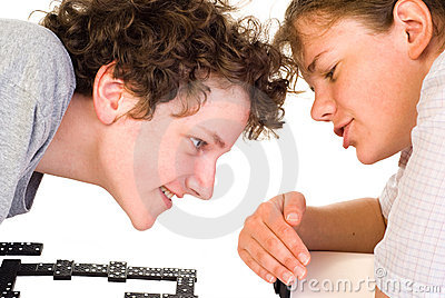 Boy and girl playing dominoes