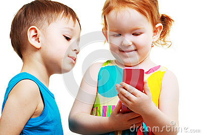 Boy and girl playing with mobile