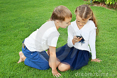 Boy and girl playing on a mobile phone