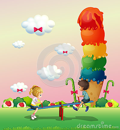 A boy and a girl playing at the park with sweets