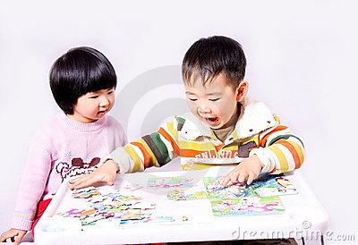 Boy and girl playing puzzle games