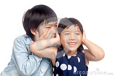 Boy and girl playing together Stock Photo