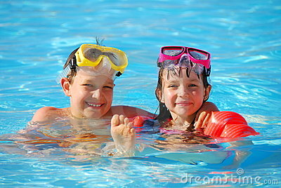 Boy and girl in pool
