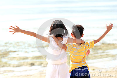 Boy and girl raises her hands