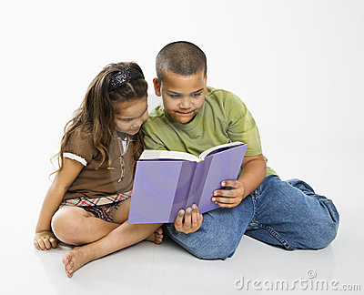 Boy and girl reading book.