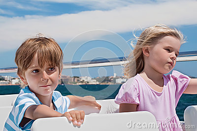 Boy and girl sailing on a yacht