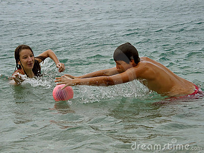 Boy and girl in sea