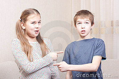 Boy and girl show each other
