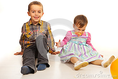 Boy and girl sitting on floor