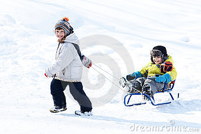 Boy and girl with sled