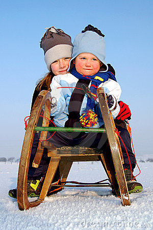 boy and girl on a sleigh
