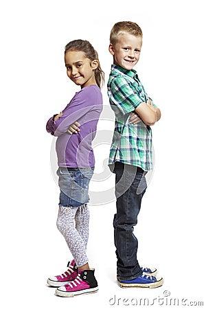 Boy and girl stood back to back