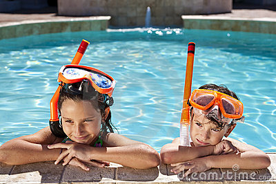 Boy & Girl In Swimming Pool with Goggles & Snorkel
