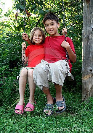 Boy and girl on swing