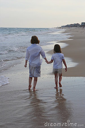 Boy and girl walking on the beach