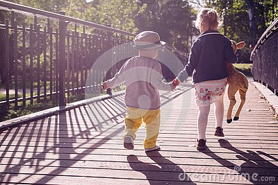 Boy And Girl Walking On Bridge During Daytime Free Public Domain Cc0 Image