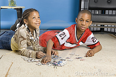 Boy and girl working on a puzzle