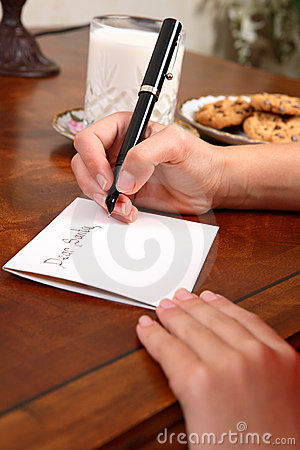 Boy or girl writing a letter to Santa