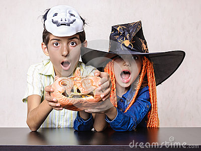 Boy and girl yelling shocked at Halloween