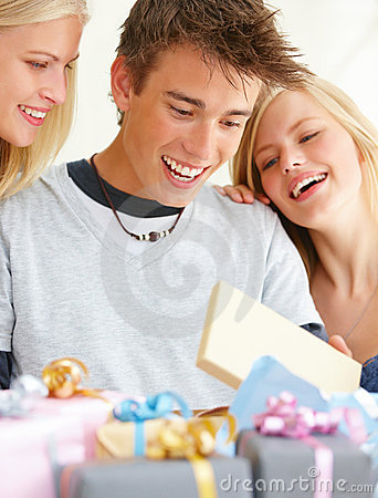 Boy with girls looking at gifts