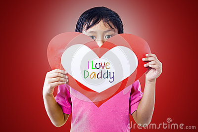 Boy give love card to dad