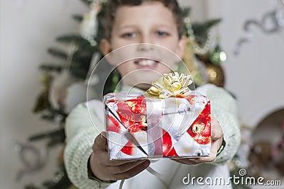 Boy gives Christmas gift